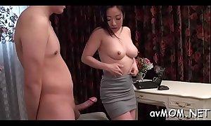 Oriental milf goes wild on three hard cocks, cum discharged